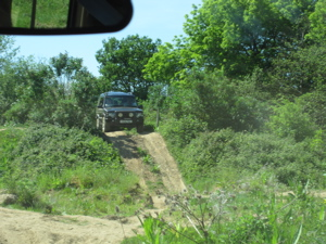 4x4 car at top of steep slope, about to descend