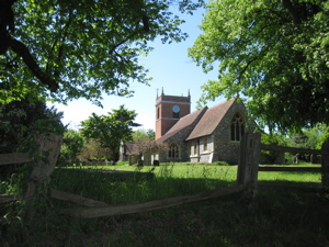 Village Church framed by trees and a fence
