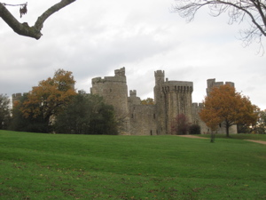 Bodiam Castle, surrounded by autumn trees
