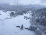 View from gondola of snow covered ski runs and chalets