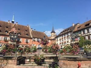 Pretty village square - medieval houses and flowers in boxes
