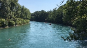 View along the river Aare, with inflatable boat and swimmers