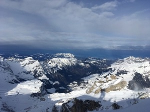 View from the peak at Engelberg, over the snow capped mountains and hills of Switzerland