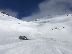 White ski-piste under blue skies