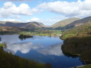 View over lake to Grasmere, with clouds reflected in water