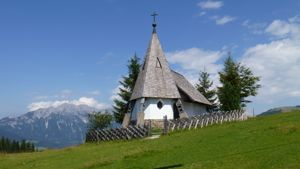 Small chapel with mountains in background
