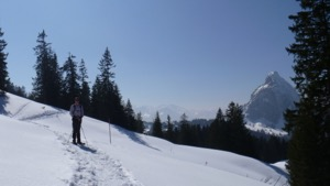 George standing on a snow shoe track, with the Grosser Mythen in the background